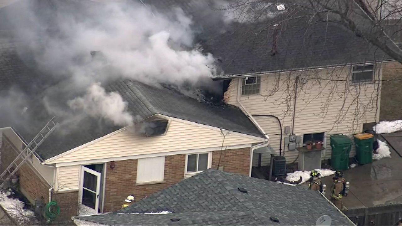 2 hospitalized as crews battle house fire in Wheeling