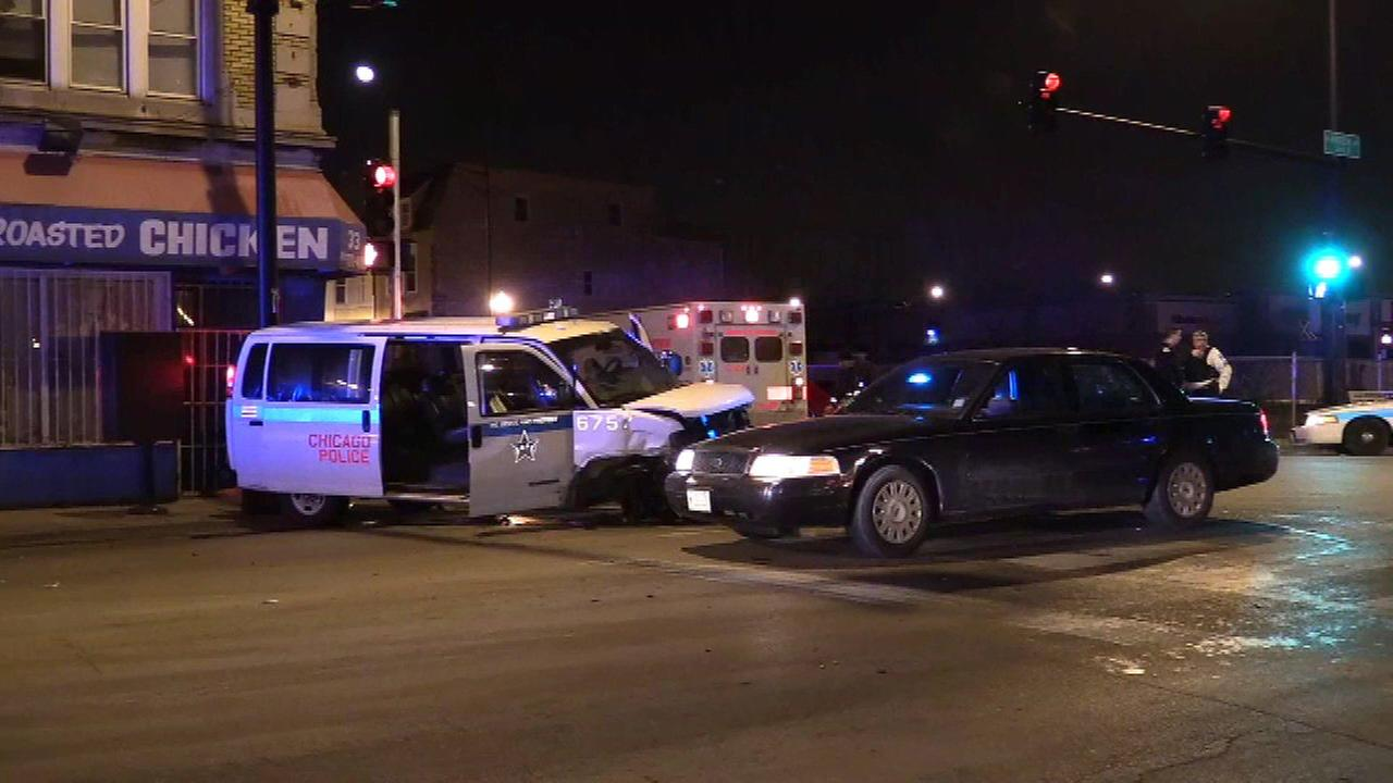 2 officers injured after car slams into police van, officials say
