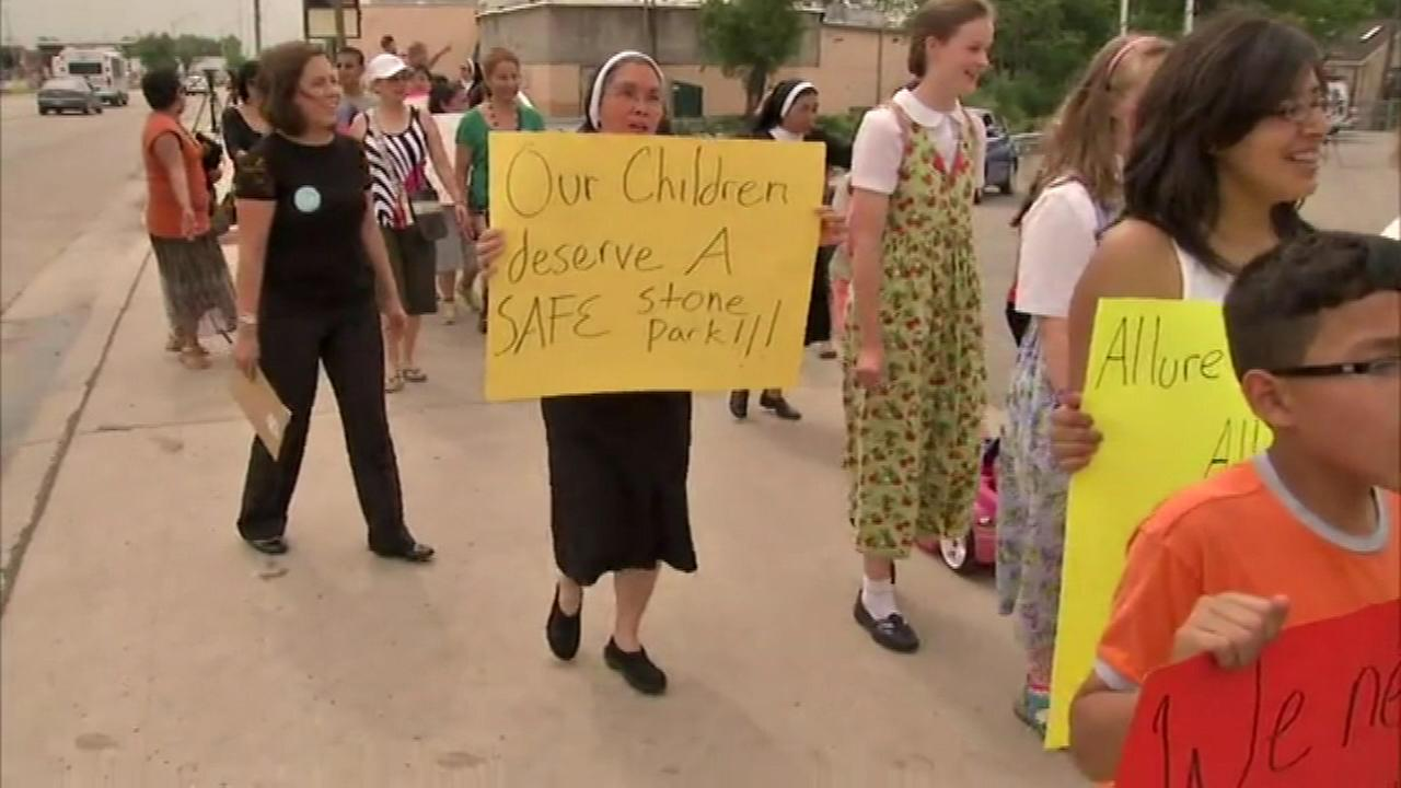 (FILE) The Missionary Sisters of Saint Charles in Stone Park protest against a neighboring strip club.