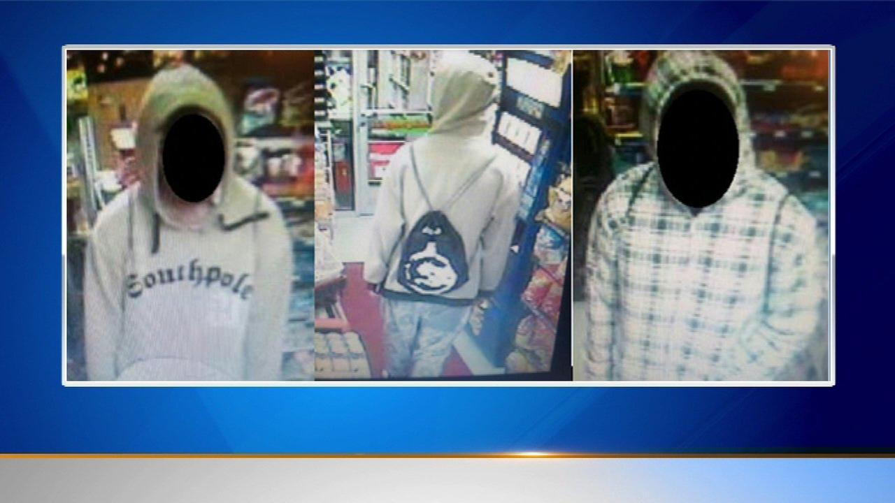 Police are searching for two men who robbed a gas station at gunpoint in suburban Palatine.