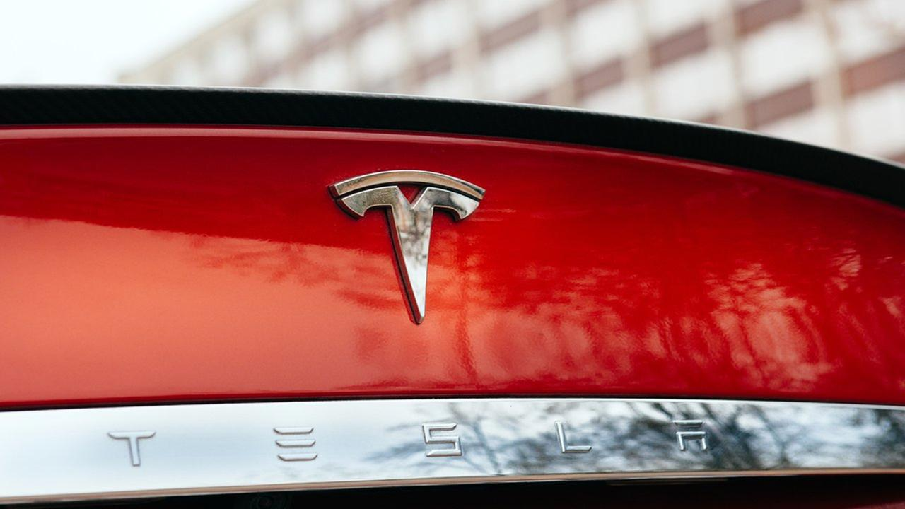 Tesla fans line up for chance to reserve $35K car