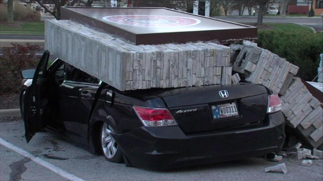 Chipotle sign crushes car with driver still inside
