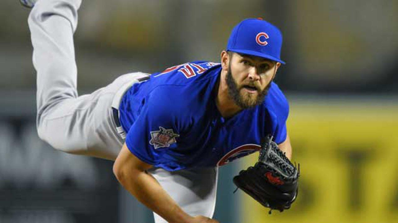 Chicago Cubs starting pitcher Jake Arrieta throws to the plate during the second inning of an opening day baseball game against the Los Angeles Angels in Anaheim, California.