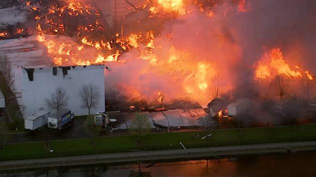 <div class='meta'><div class='origin-logo' data-origin='WLS'></div><span class='caption-text' data-credit=''>Fire crews battle an extra-alarm blaze at The RoomPlace in southwest suburban Woodridge on April 21, 2016.</span></div>