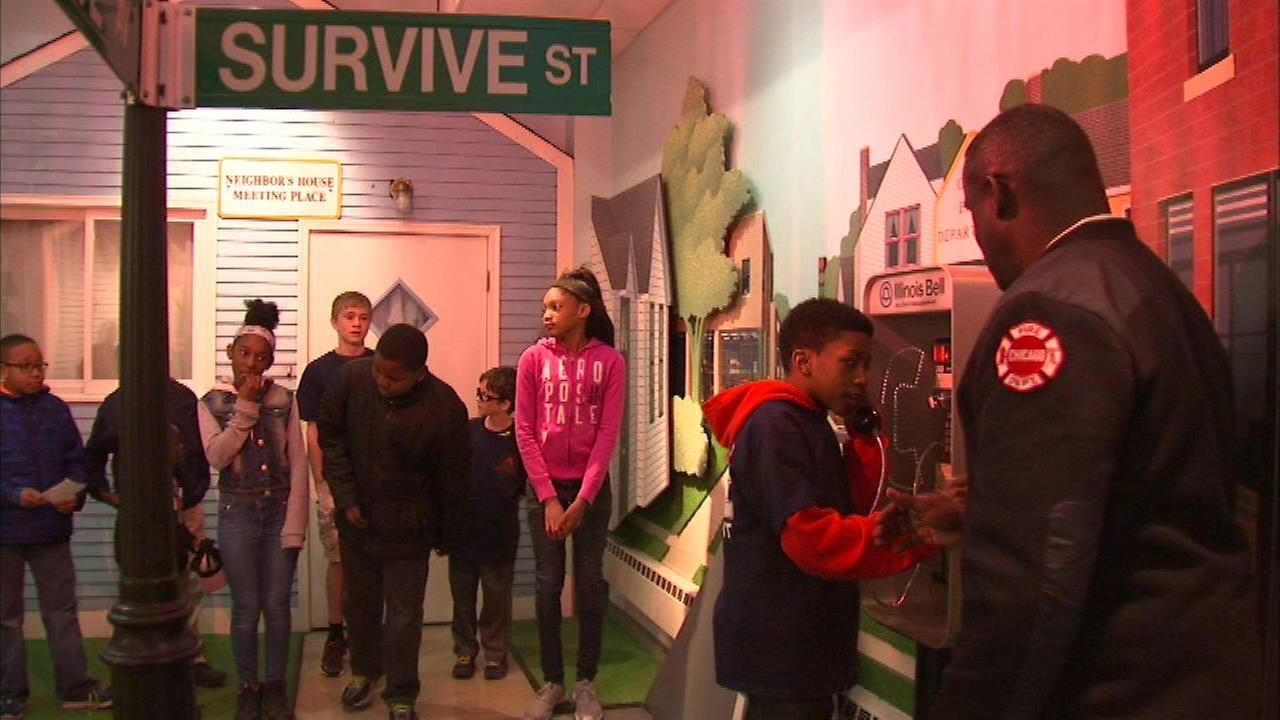 Youth learn fire safety during firefighter event