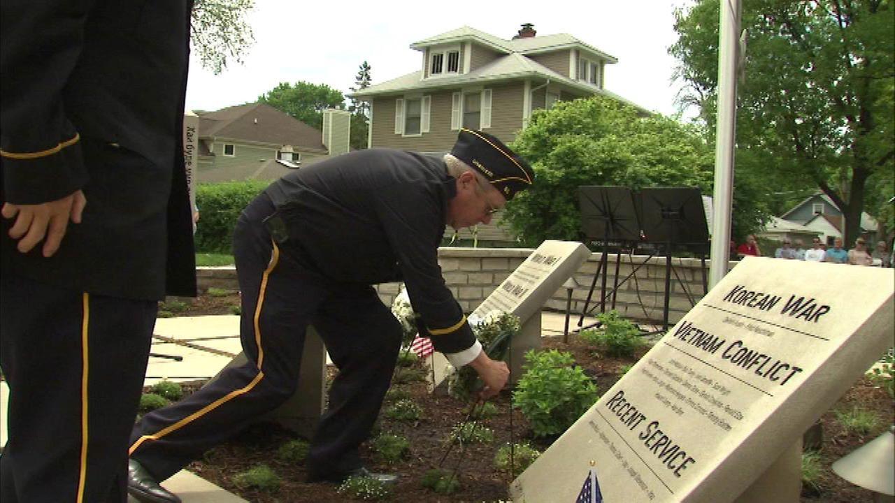 Suburban students unveil memorial peace gardens