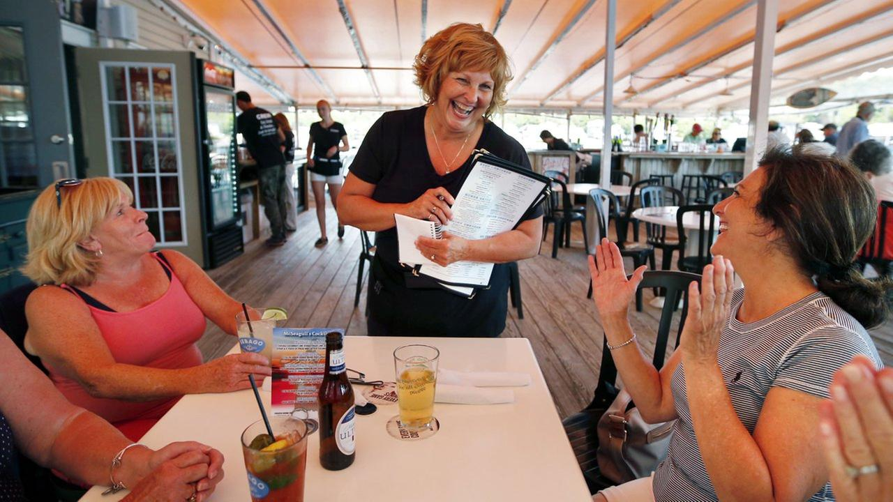 Ann LePage chats with diners after taking their order at McSeagulls restaurant, Thursday, June 23, 2016, in Boothbay Harbor.