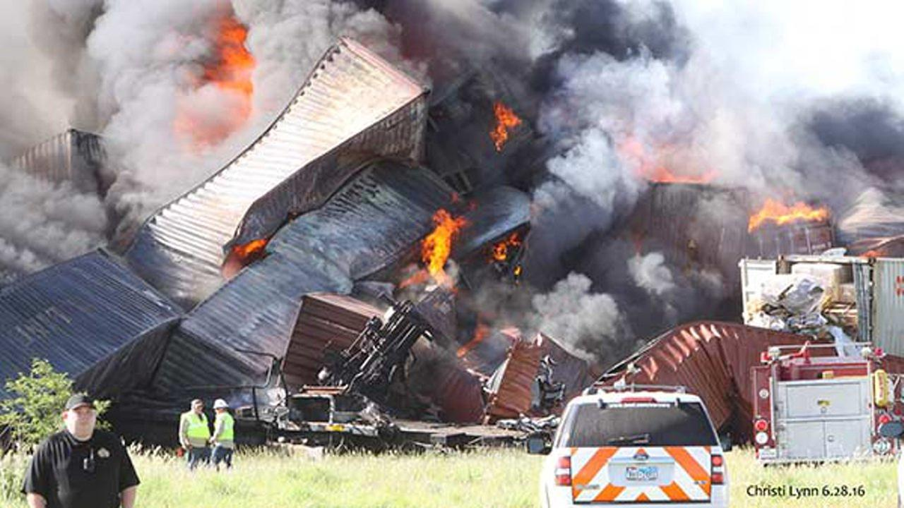 A head-on collision involving two freight trains caused several box cars to derail and erupt in flames in the Texas Panhandle on Tuesday.