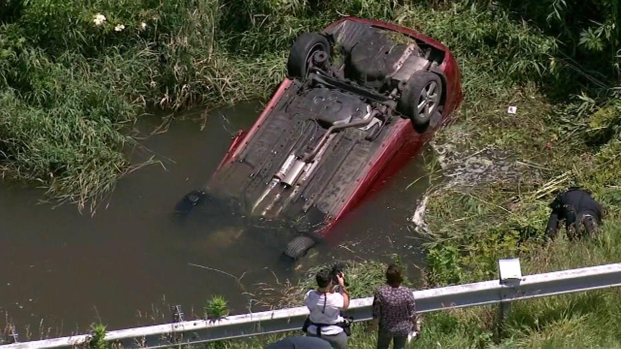 Woman, child rescued from car in Sycamore creek