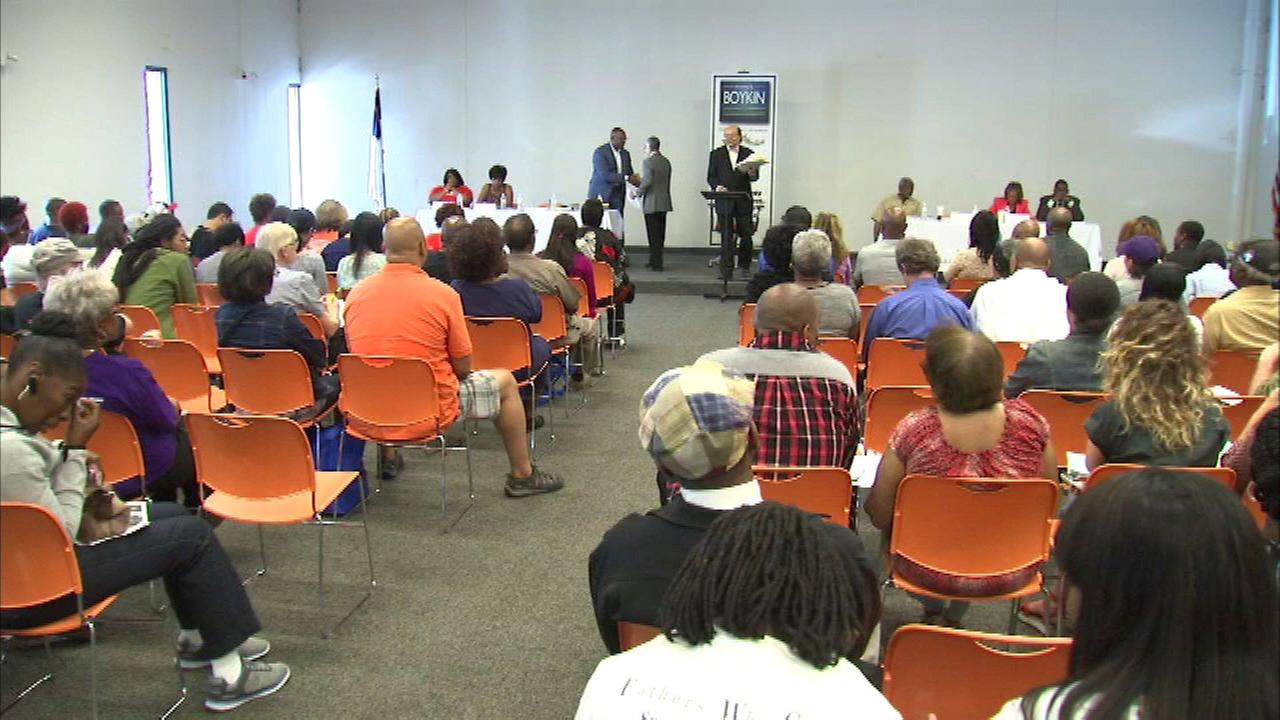 Residents at an ant-violence town hall on the West Side.
