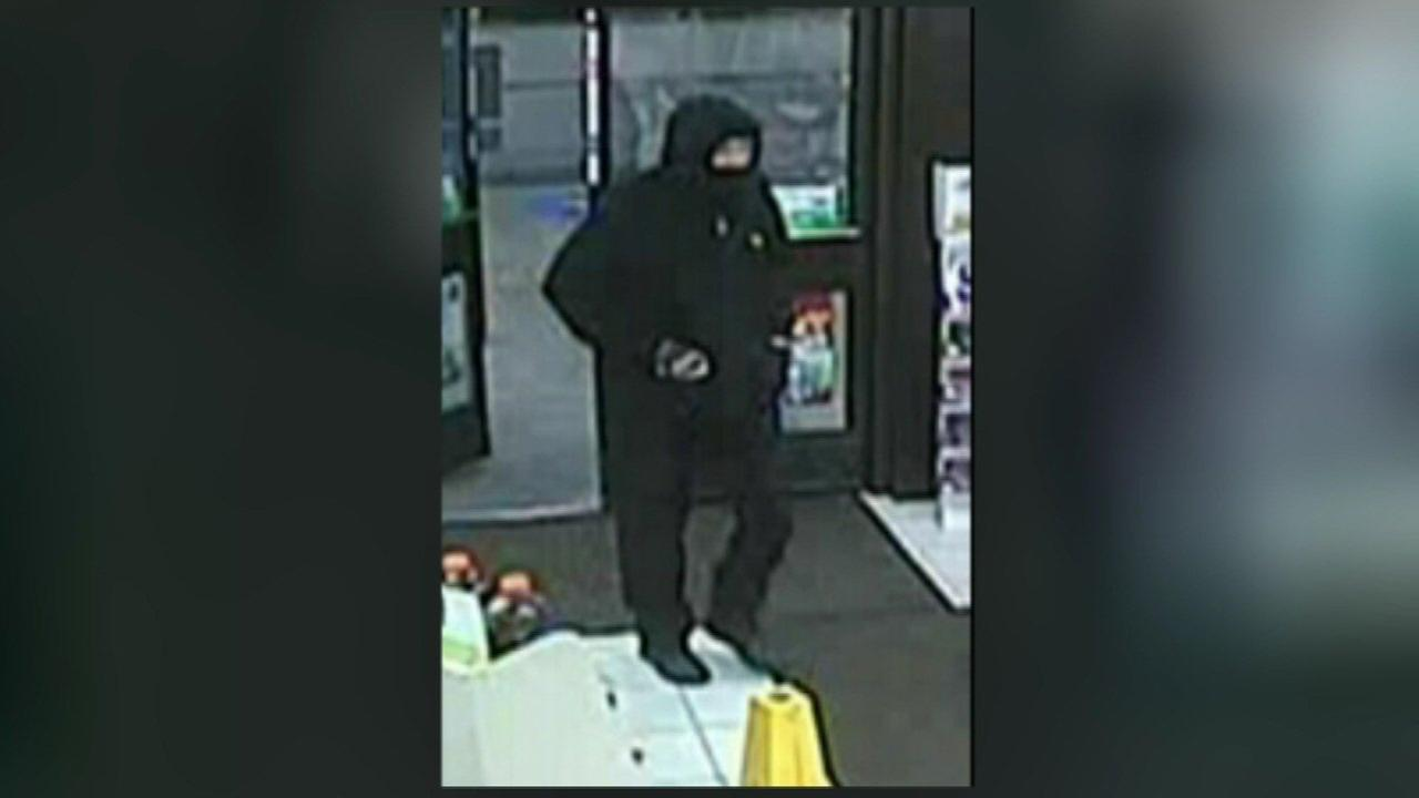 Surveillance photo of the masked suspect who robbed a 7-Eleven early Wednesday in New Lenox.