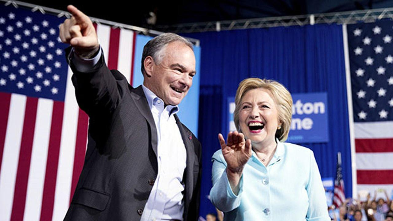 Democratic presidential candidate Hillary Clinton and Sen. Tim Kaine, D-Va., arrive at a rally at Florida International University Panther Arena in Miami.