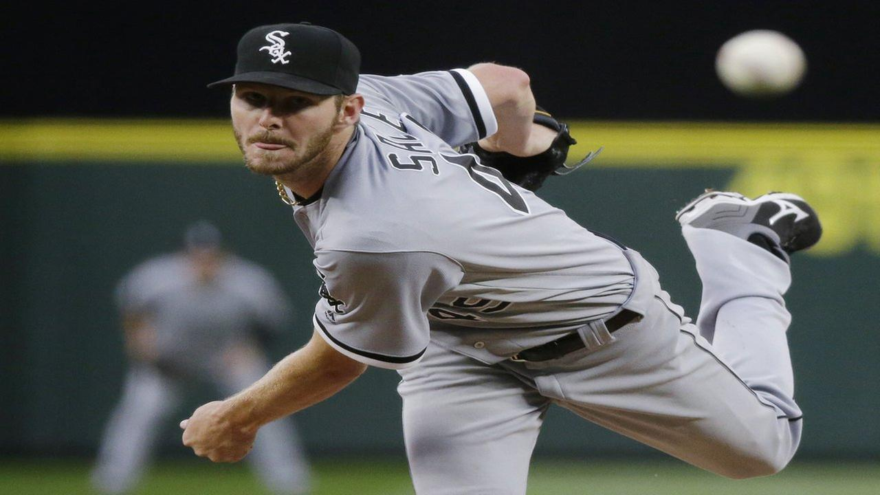 In this Monday, July 18, 2016, file photo, Chicago White Sox starting pitcher Chris Sale throws to a Seattle Mariners batter during a baseball game in Seattle.