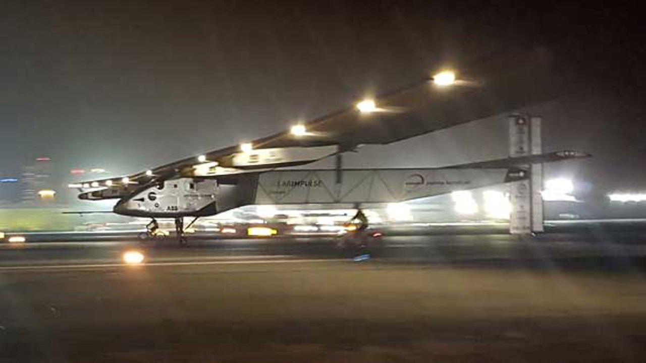The Solar Impulse 2 plane lands in an airport in Abu Dhabi, United Arab Emirates.