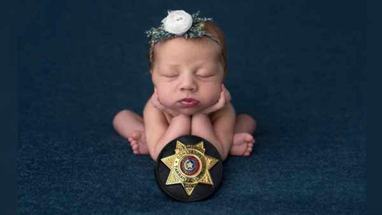 Destiny Hall, 26, and her husband Caleb, 28, of Granbury, honored the deputy by photographing their newborn, Evelyn, with his badge.  Cyndi Williams Photography/ABC News