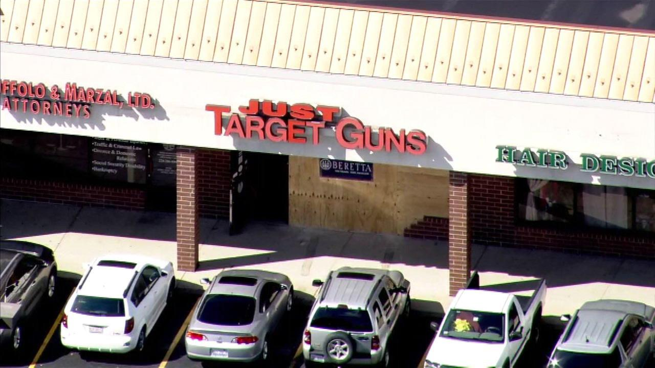 The window of Just Target Guns in Libertyville is now boarded up.