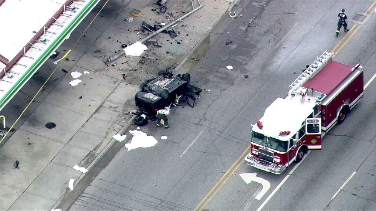 The vehicle rolled over and caught fire near the BP gas station near 9th Avenue and Roosevelt.