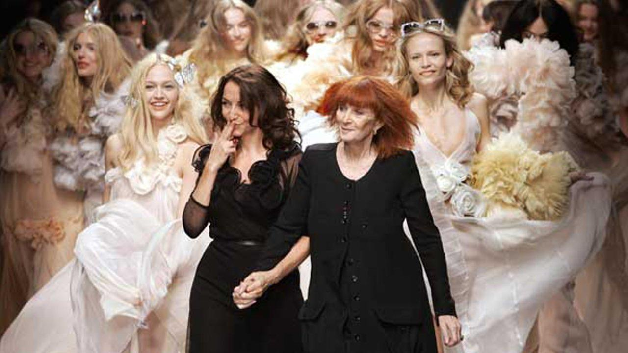 In this Oct.5, 2007 file photo, French designers Sonia Rykiel, right, and her daughter Nathalie Rykiel, acknowledge applause after the presentation of their Spring-Summer 2008 Ready-to-Wear collection, in Paris.