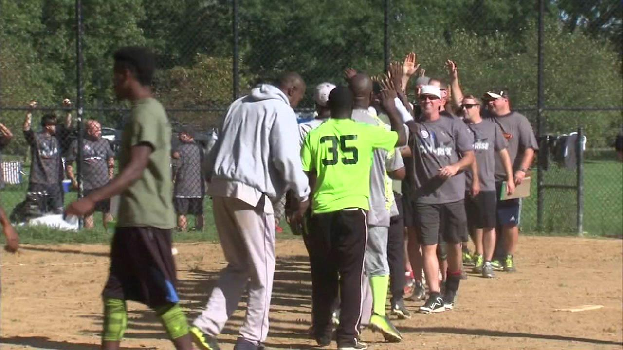 Softball brings together police officers, Englewood residents
