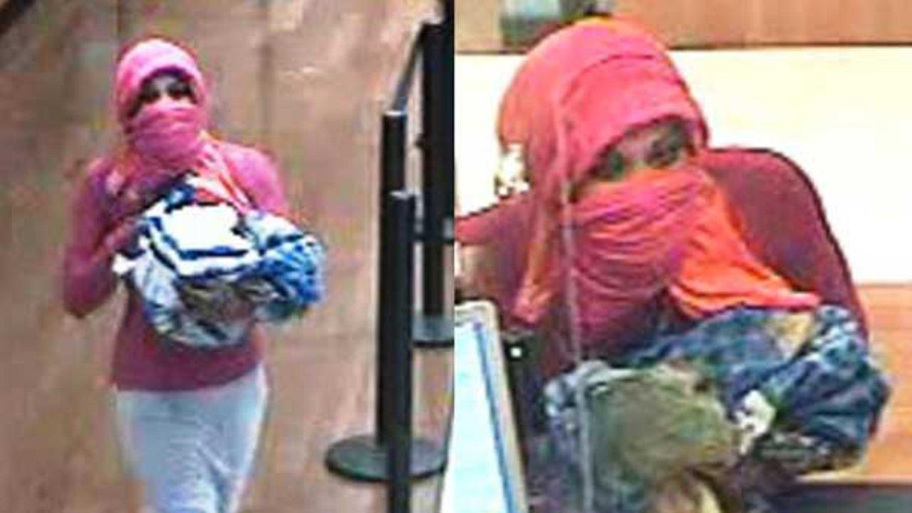 Surveillance photos of a woman suspected of robbing a Chase Bank branch on Sept. 13 in Riverdale. | FBI