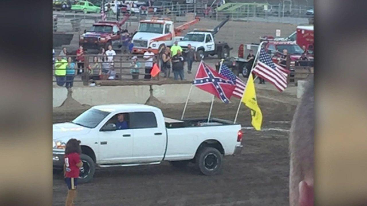 Family sits during national anthem because of Confederate flag