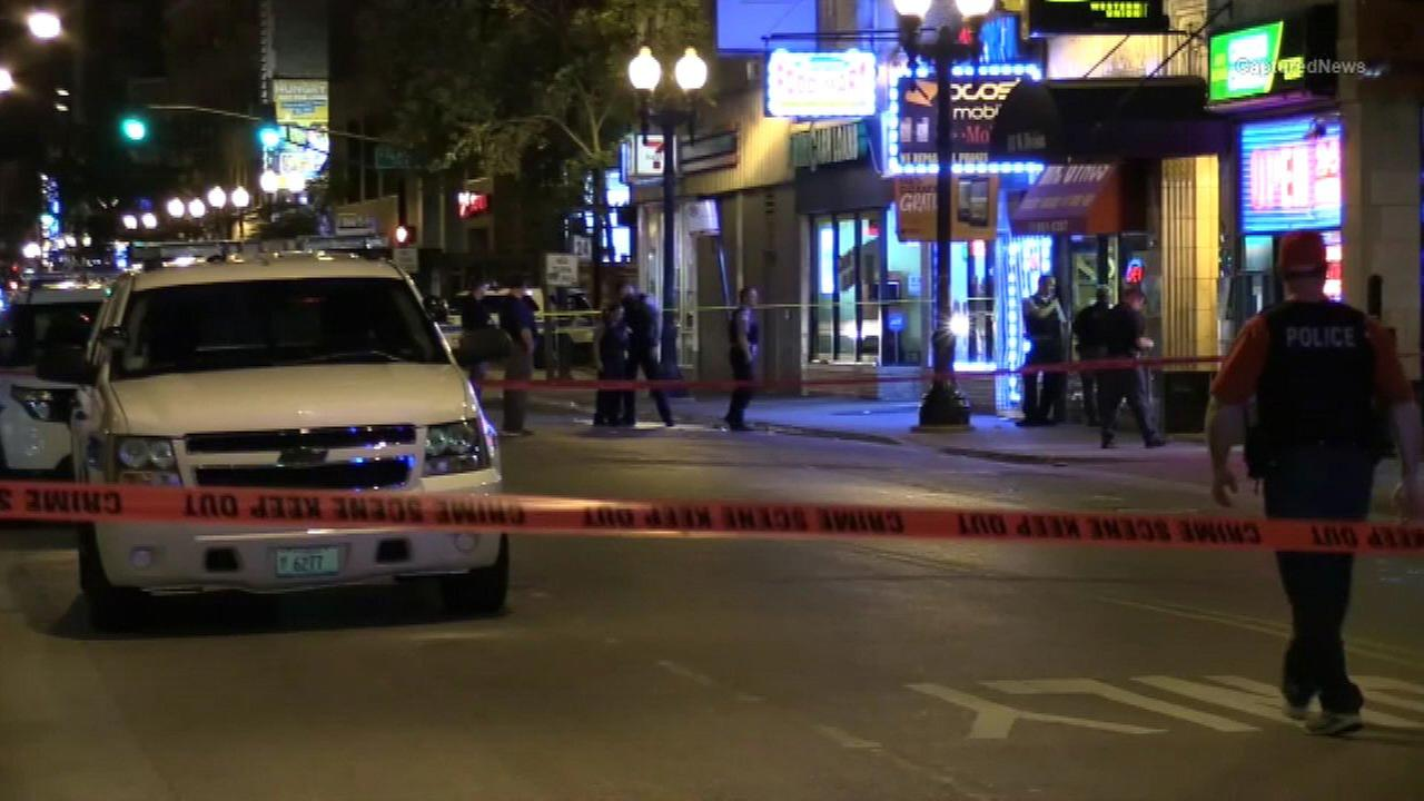 Chicago police investigate a fatal shooting in the 100-block of West Division Street.
