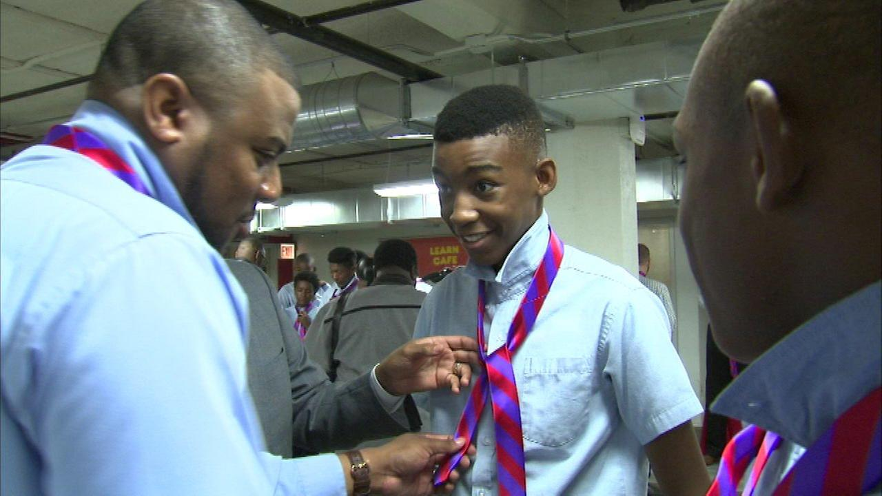 Middle school boys receive neckties with positive community message