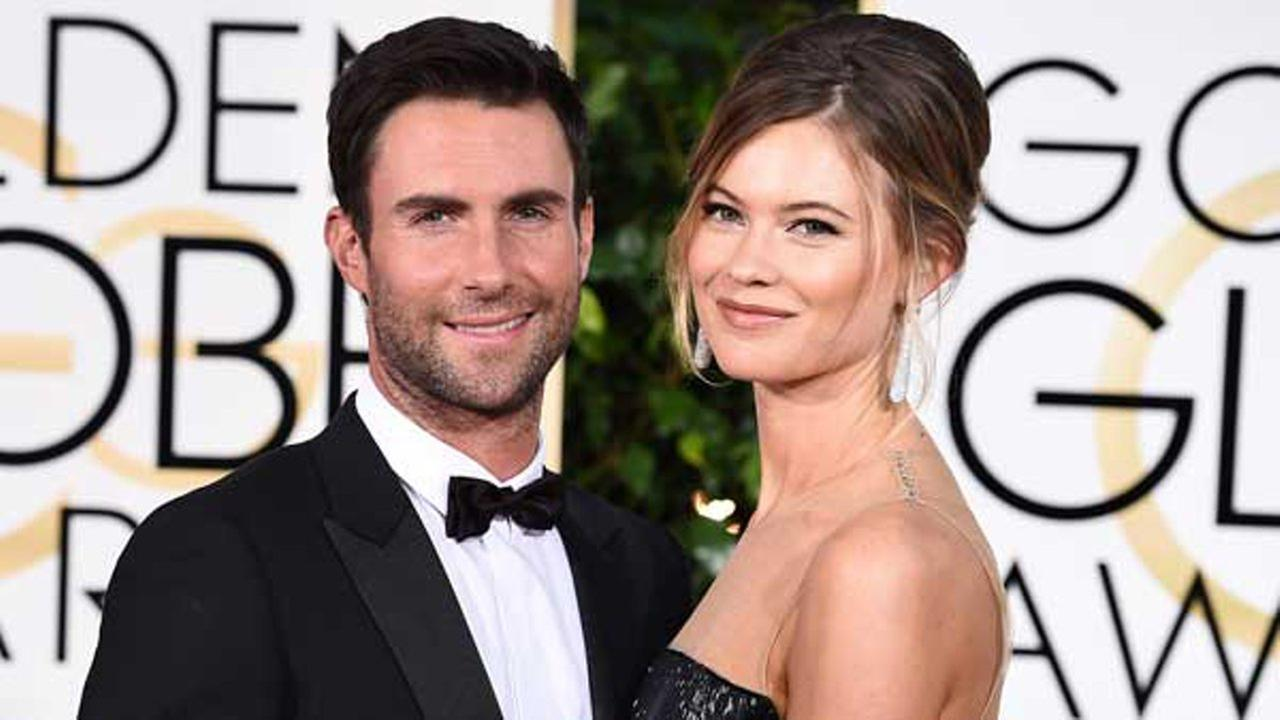 In this Jan. 11, 2015 file photo, Adam Levine, left, and Behati Prinsloo arrive at the 72nd annual Golden Globe Awards in Beverly Hills, Calif.
