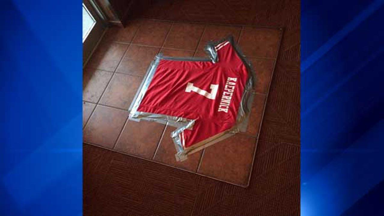 Colin Kaepernick jersey taped to restaurant floor