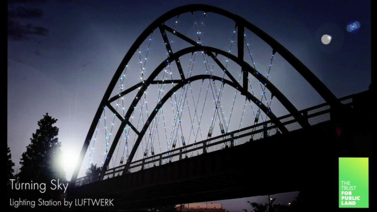 A new art installation will light up the Milwaukee Avenue Bridge over the 606 Trail in Chicagos Wicker Park neighborhood.