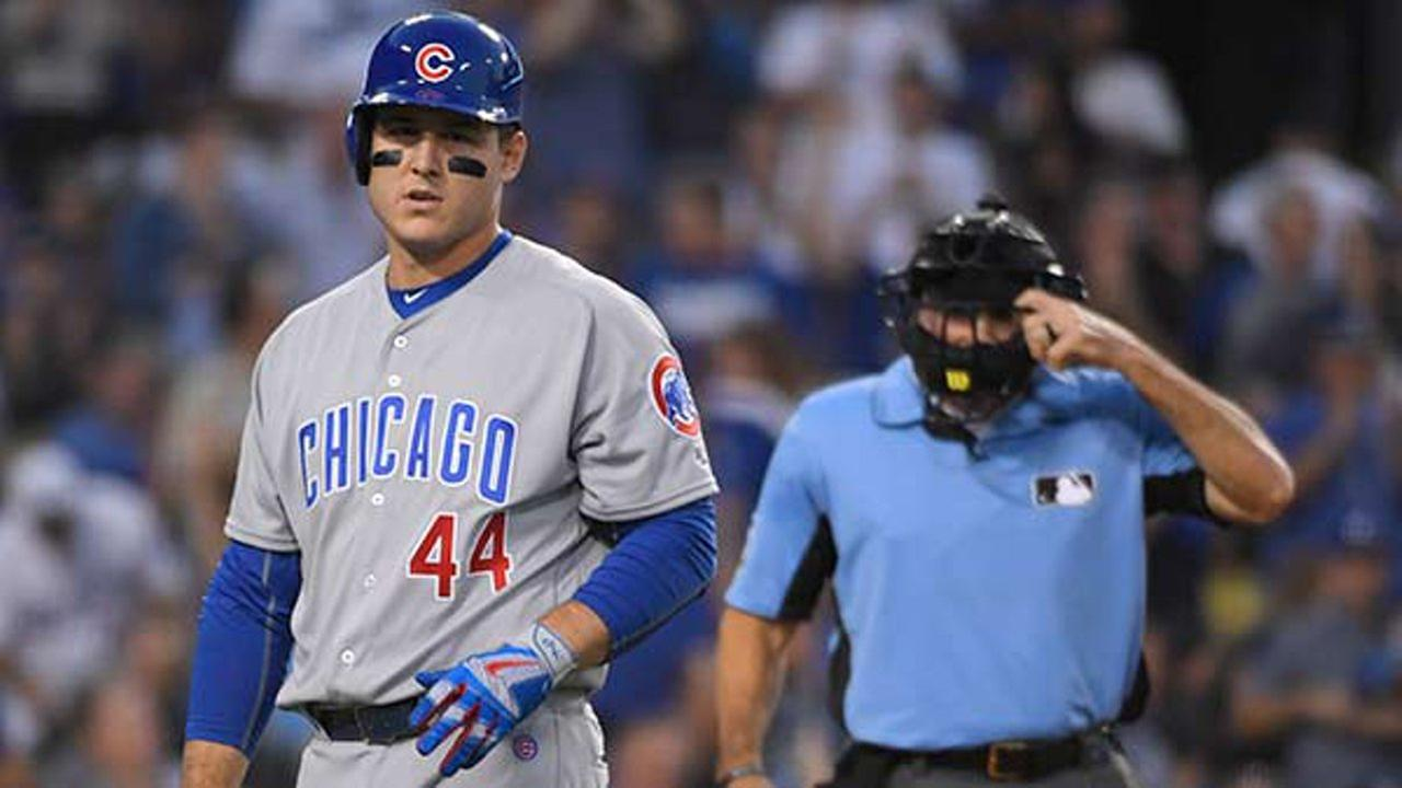 Chicago Cubs Anthony Rizzo walks back to the dugout after striking out during the third inning of Game 4 of the National League baseball championship series.