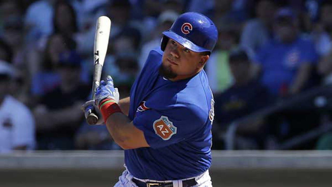 In this March 25, 2016, file photo, Chicago Cubs Kyle Schwarber swings against the Milwaukee Brewers during a spring training baseball game in Mesa, Ariz.