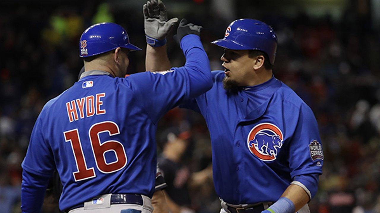 Chicago Cubs Kyle Schwarber is congratulated by first base coach Brandon Hyde after hitting an RBI single during the fifth inning of Game 2.