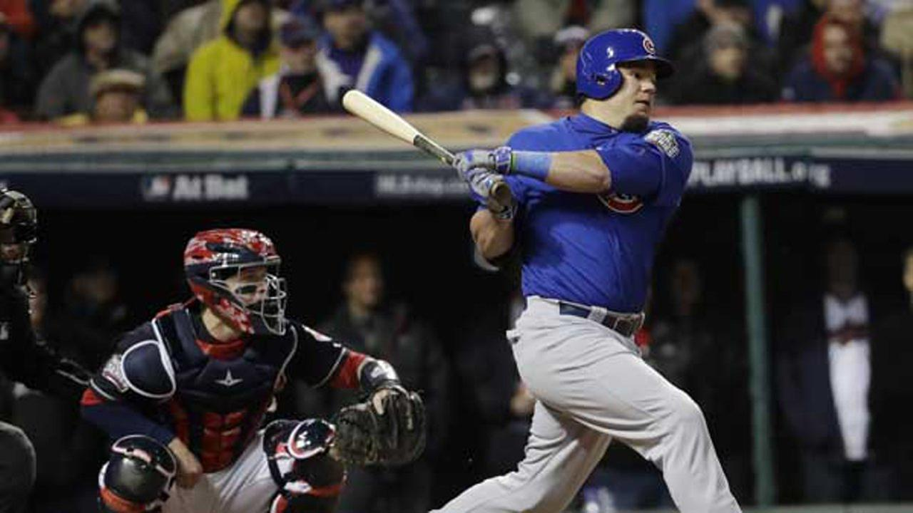 Chicago Cubs Kyle Schwarber hits an RBI single during the third inning of Game 2 of the Major League Baseball World Series against the Cleveland Indians.