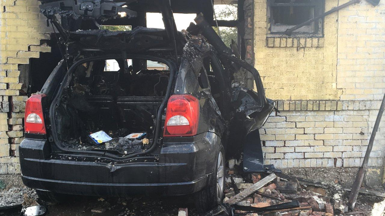 Car crashes into abandoned gas station, catches fire