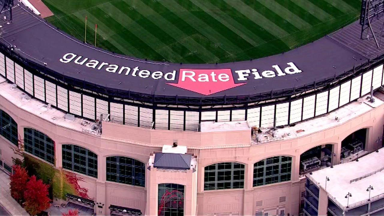 Crews removed U.S. Cellular Field signs and installed the new logos on Monday.