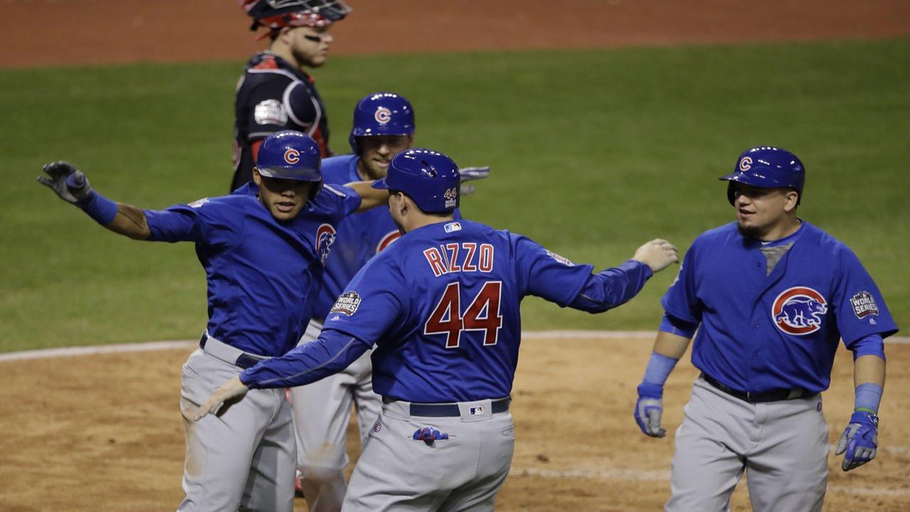 Chicago Cubs Addison Russell celebrates after hitting a grand slam during the third inning of Game 6 of the Major League Baseball World Series against the Cleveland Indians Tuesday, Nov. 1, 2016, in Cleveland. AP Photo/Gene J. Puskar