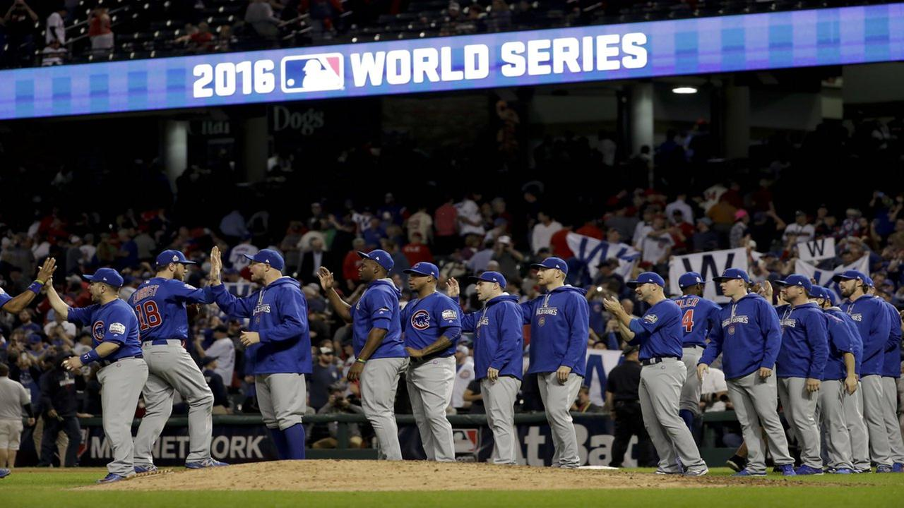 The Chicago Cubs celebrate after their win in Game 6 of the Major League Baseball World Series against the Cleveland Indians Tuesday, Nov. 1, 2016, in Cleveland. The Cubs won 9-3 to tie the series 3-3.