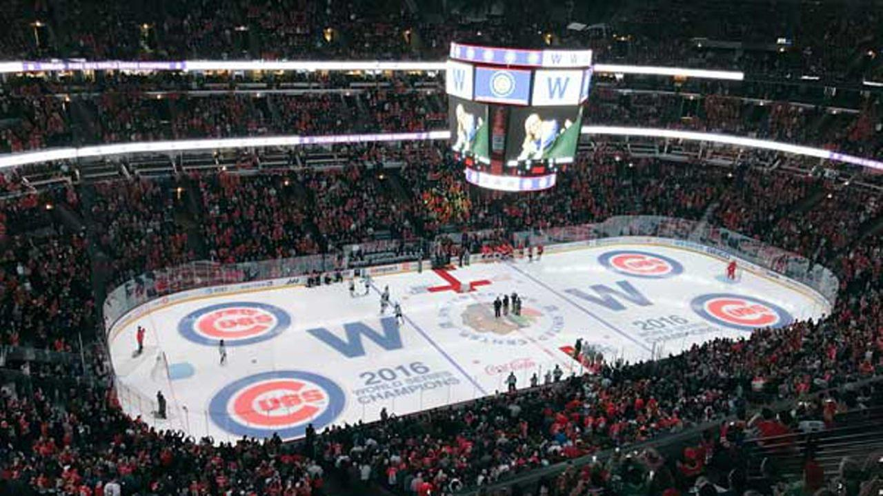 The ice and scoreboard at the United Center was decorated with the Cubs logo to pay tribute to the teams first World Series victory in 108 years. @NHLBlackhawks