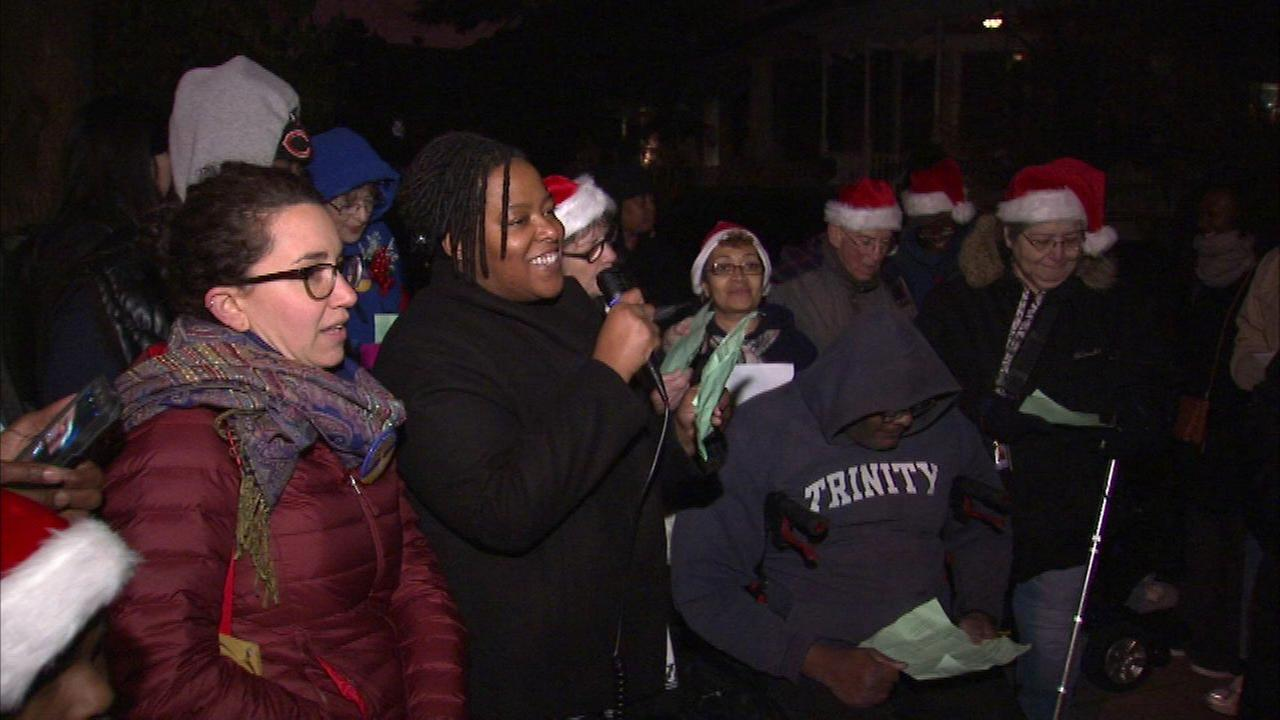 Homeless advocates carol for a cause outside mayor's house