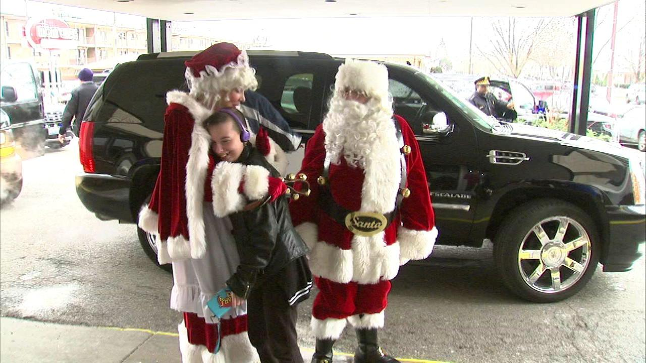 Chicago police officers joined Santa and Mrs. Claus to deliver gits tot he families of officers killed or injured in the line of duty.