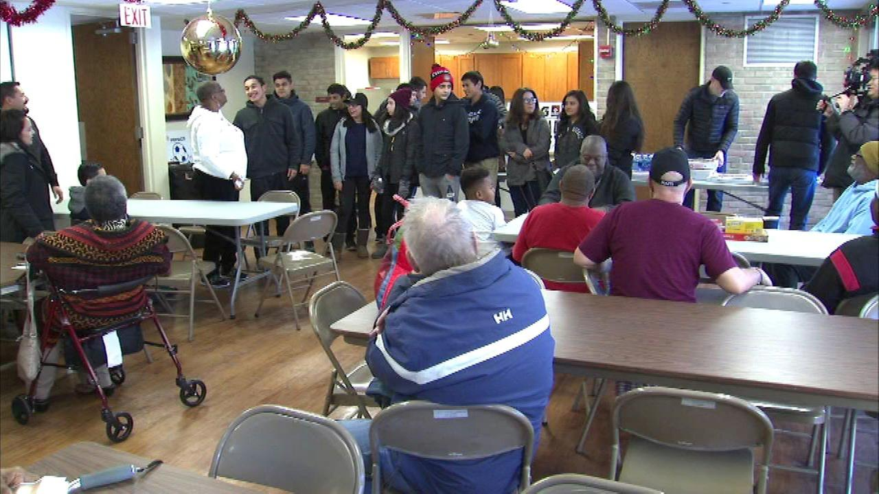 High school students throw a surprise party at the Pearlman Senior Center in Evanston.