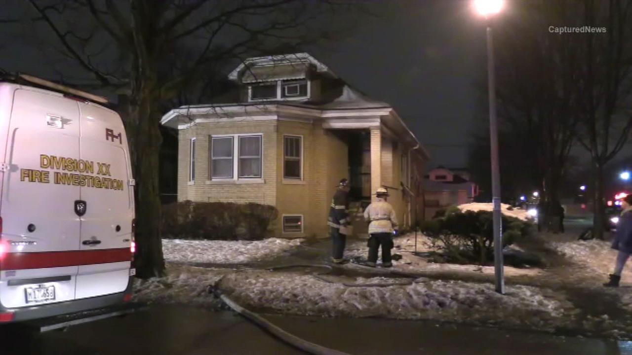 Firefighters on the scene of a fatal fire in west suburban Maywood.