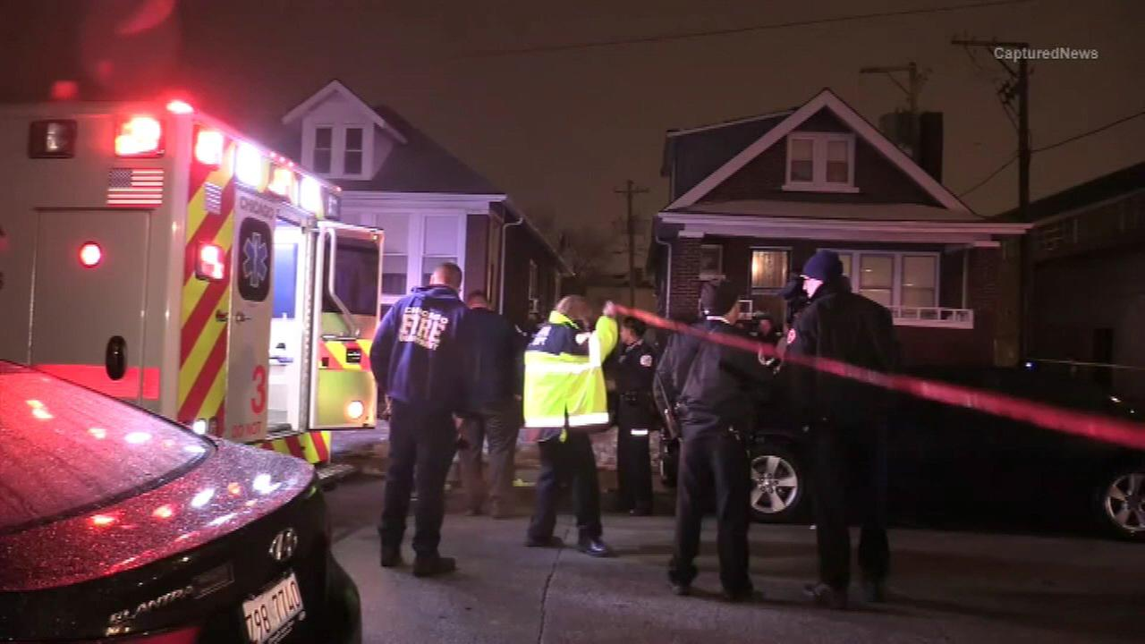 Chicago police investigate a deadly mass shooting in the East Chatham neighborhood.