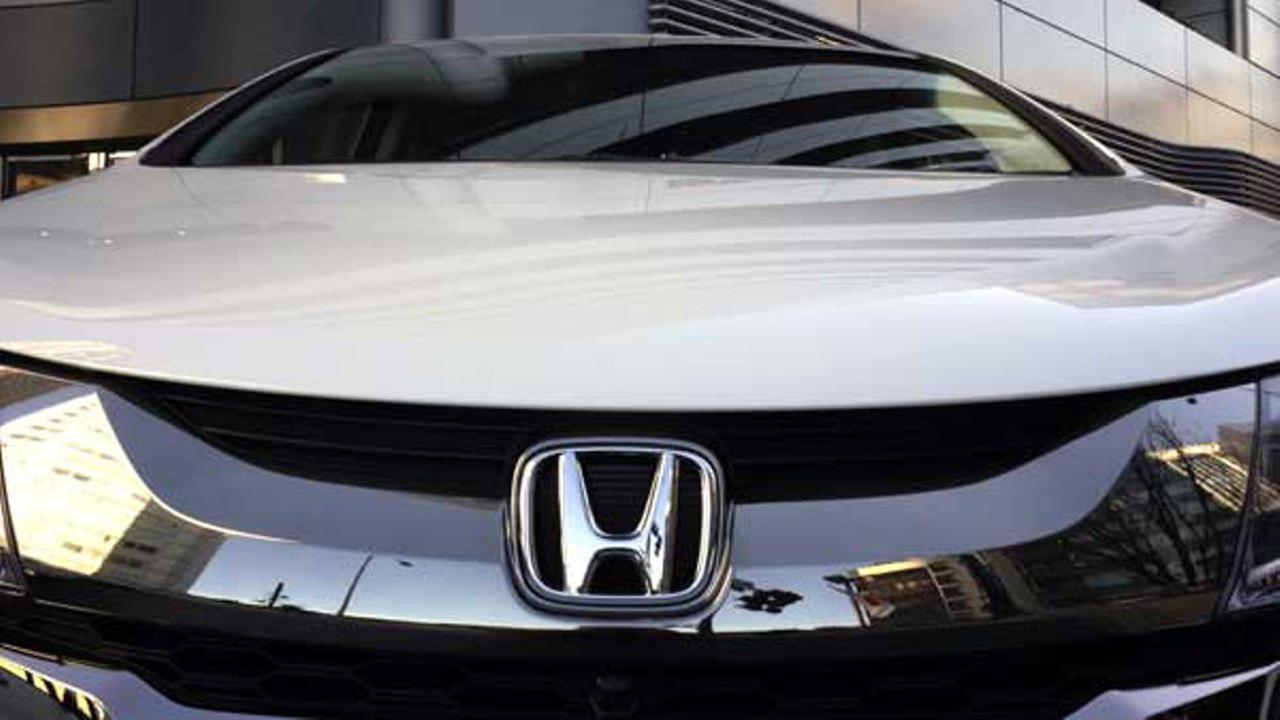 The logo of Honda Motor Co. is seen on a Honda vehicle at the Japanese automakers headquarters in Tokyo.