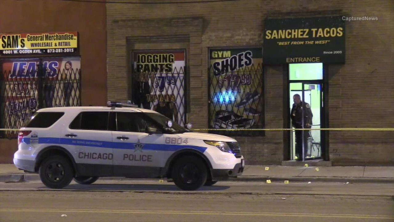 Chicago police investigate a shooting at a restaurant in the Little Village neighborhood.