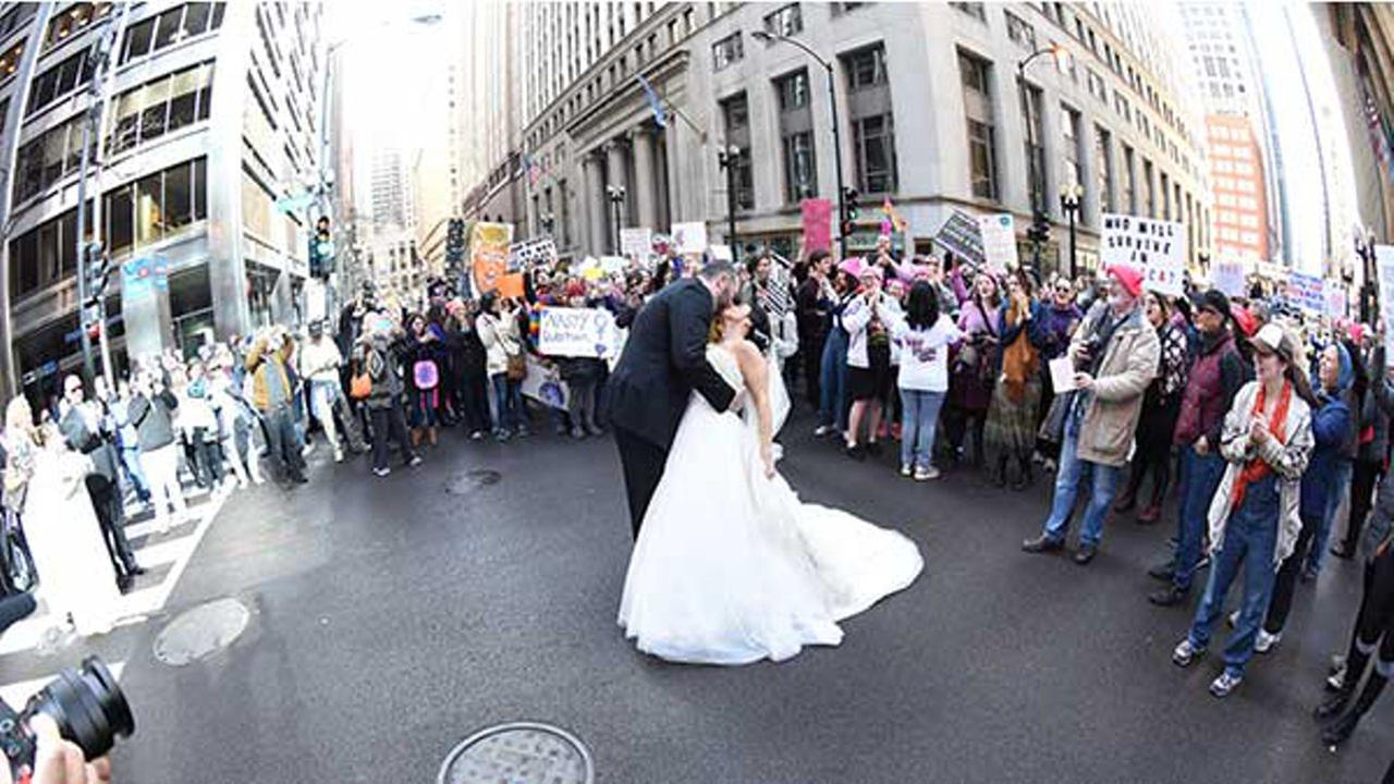 Allison Baker and Marko Milincic had their pre-wedding photos shot at State and Monroe Streets on Saturday during the Womens March on Chicago.Jai Girard
