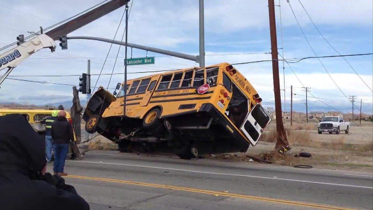 Ten students were injured - one critically - after a school bus and a vehicle crashed in Lancaster, California.