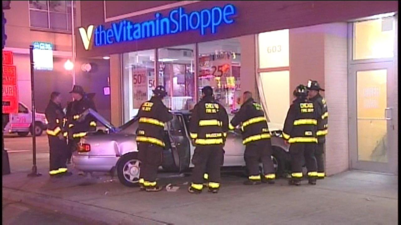 A car crashed into a building in the South Loop after hitting a tow truck.