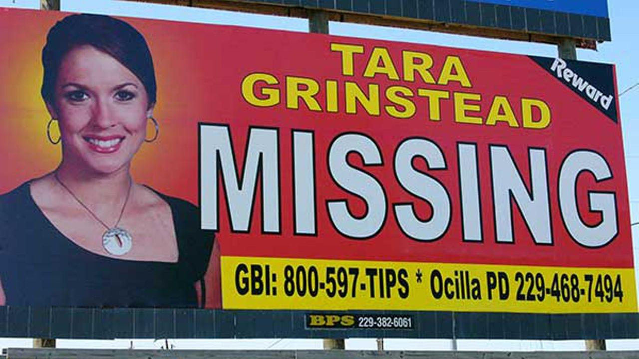 The Wednesday, Oct. 4, 2006, file photo of missing teacher Tara Grinstead is prominently displayed on a billboard in Ocilla, Ga.
